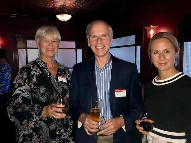 Three attendees at networking